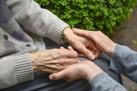 Touches the hands of an old woman-Concept of Elderly care