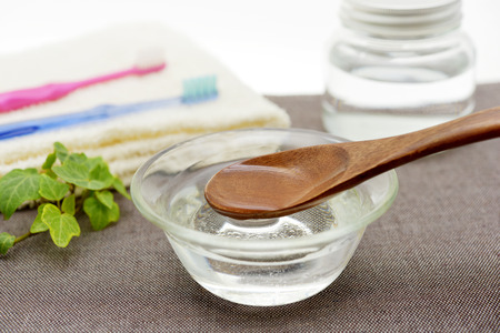 Coconut oil pulling-image of oral care