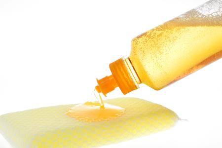 Vaatwasmiddel (mengen met sinaasappelolie) Stockfoto