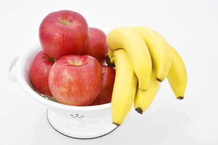 Apples and banana on white bowl 写真素材