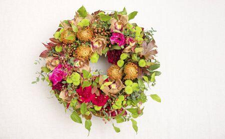 Flower arrangement : pincushions, cymbidium, Chrysanthemum, carnation, gladiolus, stemona japonica, eucalyptus, hypericum,  wild rose 写真素材