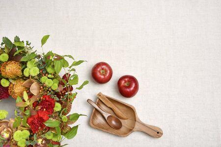 Botanical frame : Flower arrangement and apples on a cloth background.