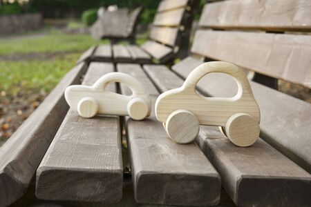 Wooden Toy Cars on Wooden Bench.