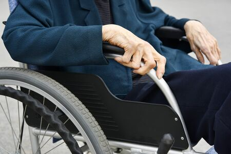 Close Up of Elderly Woman and Wheelchair. Stok Fotoğraf