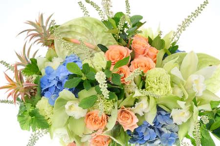 Flower arrangement on white background : cymbidium, carnation, anthurium, rose, hydrangea, clethra alnifolia, currant leaves, ornamental ananas 写真素材