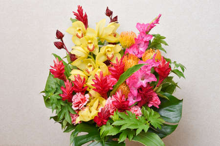 Flower arrangement : Cymbidium, Carnation, Red ginger, Roselle, Gladiolus, Raspberry, Monstera, Dracaena
