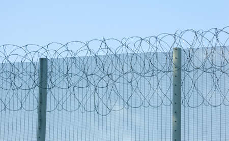 prison fence: Barbed wire prison fence