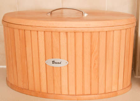 Wooden bread bin in the kitchen photo