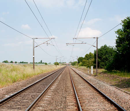 Photo of a railway track in summer photo