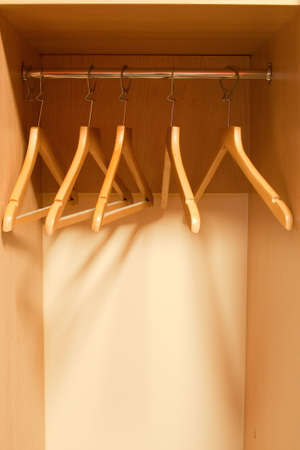 Photo of an empty wardrobe with hangers photo