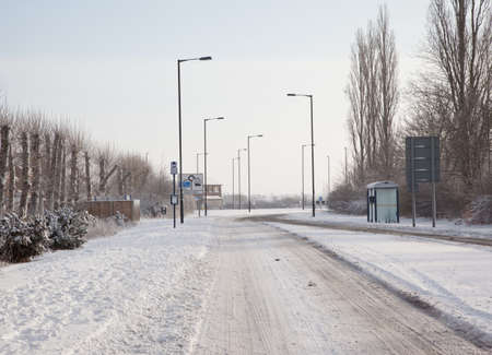 Snowy road in winter photo