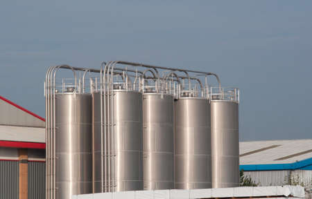 Industrial storage tanks in an industrial yard Stock Photo - 21857621
