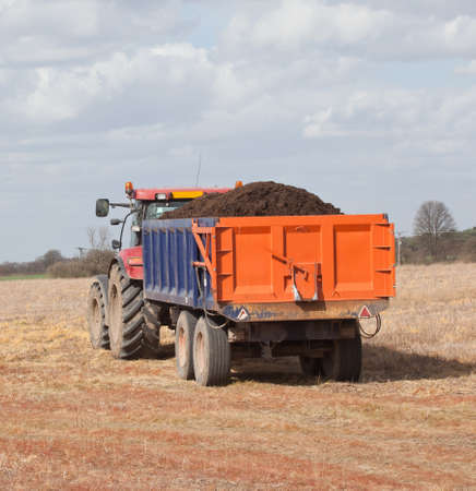 Tractor and trailer in a field photo
