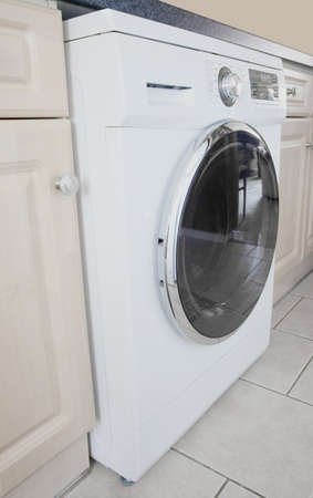 Washing machine in a modern kitchen photo