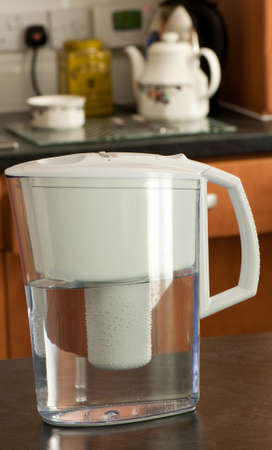 limescale: Modern water filter complete with kettle in the background