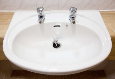 splashback: White sink close up