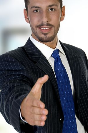 man offering hand shake on an abstract background Stock Photo - 3587019
