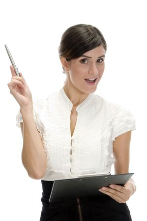 26: posing lady with pen and writing pad on an isolated background Stock Photo