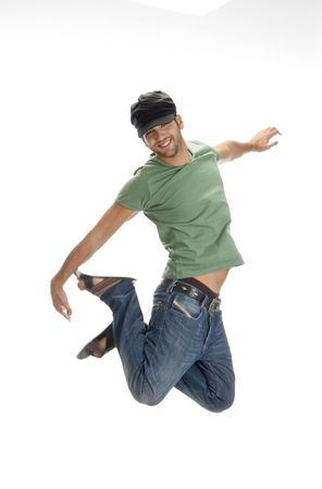young man leaps in air on an isolated white background