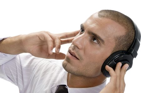 businessman holding headphone on an isolated white background photo