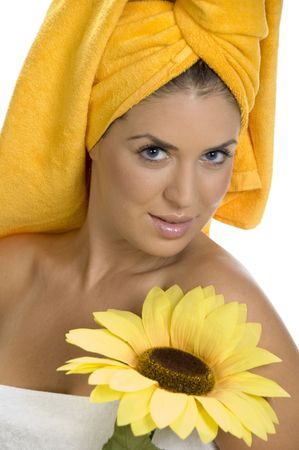 posing smiling sexy female in towel with sunflower photo