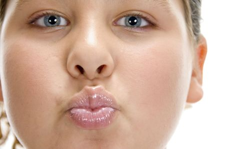 pout: girl making pout mouth on an isolated white background