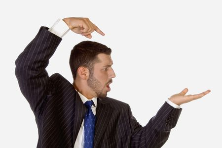 surprised businessman pointing his palm on an isolated white background photo