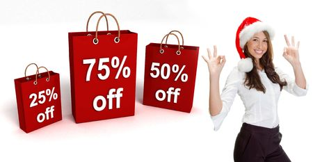 three dimensional shopping bags and woman with santa hat on an isolated white background photo