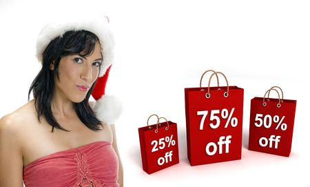 three dimensional shopping bags and sexy woman with santa hat on an isolated white background photo