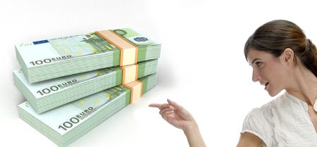 europian: business woman pointing at three dimensional bundles of europian currency on an isolated white background