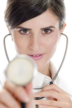 26: lady doctor posing with stethoscope on an isolated background