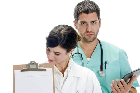 medical professionals with paper in writing board against white background Stock Photo - 3708630