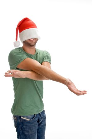 male hiding his face with santa cap on an isolated background Stock Photo - 3708622