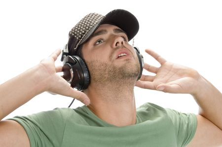 young man with cap and headphone on an isolated background Stock Photo - 3708657