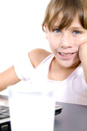 healthy girl with milk and laptop on an isolated background photo
