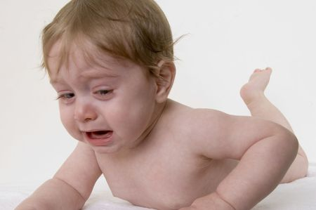 cheerless: crying small child on an isolated background Stock Photo