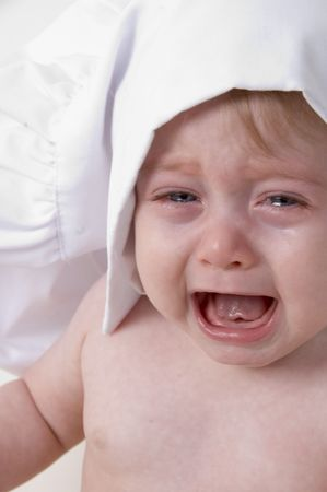 portrait of crying little baby chef Stock Photo
