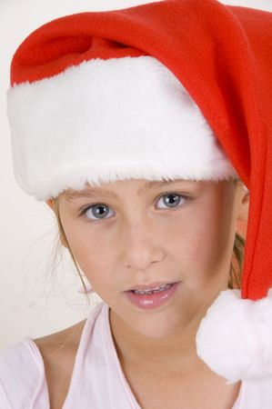 smiling little girl wearing christmas hat photo