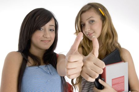 goodluck: young friends wishing goodluck on  an isolated white background  Stock Photo