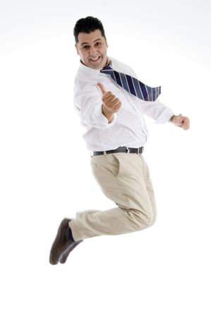 posing  agree: jumping businessman showing approval sign on  an isolated white background