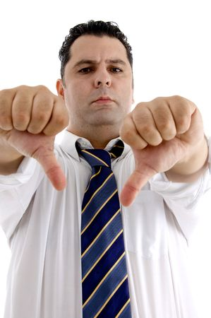 serious businessman showing thumb down gesture on  an isolated white background  photo
