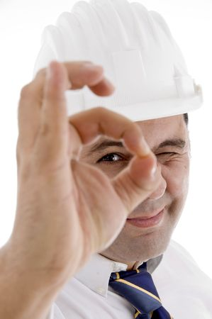 smiling architect showing ok gesture on  an isolated white background  photo