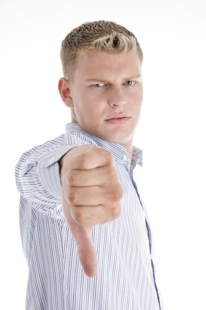 man showing disapproval sign on an isolated background photo