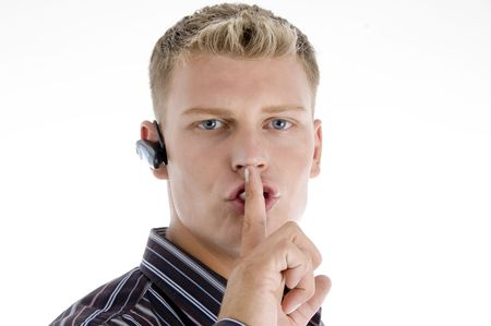 shushing: handsome male shushing isolated on white background Stock Photo