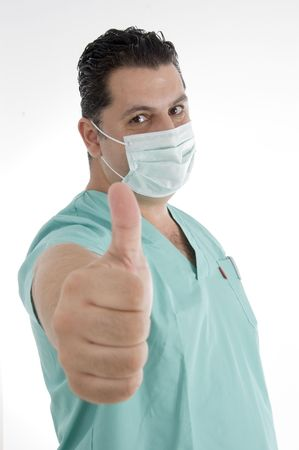 doctor with mask on his mouth showing thumb gesture against white background Stock Photo - 3757759