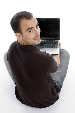 back pose of man with notebook against white background