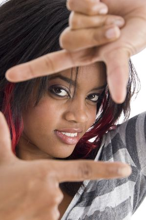 girl showing framing hand gesture on an isolated background