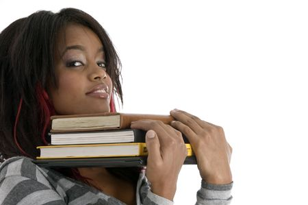 girl keeping her chin on books on an isolated white background photo