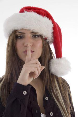 guardar silencio: chica pidiendo a guardar silencio con fondo blanco Foto de archivo