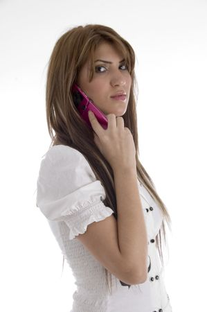 woman talking on cell phone against white background photo